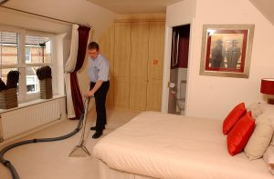 chemdry man cleaning carpet