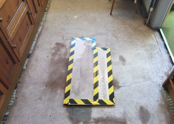 warning boards on floor