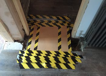 warning tape on floor